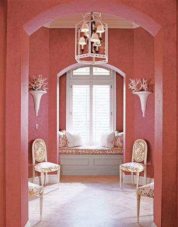 I love the arches, lighting and paint color, but not a fan of the chair placement.