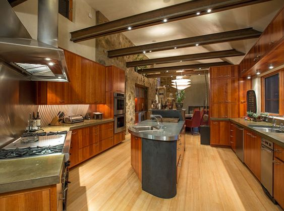 In Oprah's grand Colorado mansion kitchen, wood-panelled ceilings  brighten up the space.