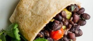 Lime Cilantro Black Bean Burritos Recipe.  I added leftover shredded chicken, corn, sauteed onions and peppers, a little bit of cumin and skipped the crushed red pepper.  Then made them as a taco because of the size tortilla I had.  They were really good and super cheap.