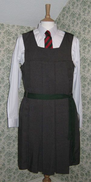 Traditional British uniform gymslip. Lord Have Mercy this was my school uni. The only difference is the tie was blue, gold and black.