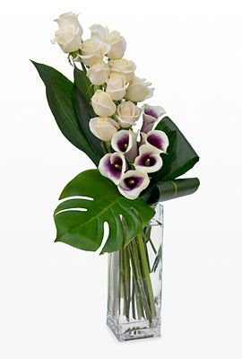 vase tribute with roses and Picasso mini calla lily sympathy design: