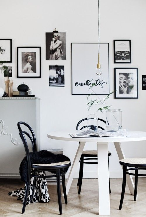 Cool black & White Dining Area - really liking the use of of framed art/photography on the walls - adds interest against the stark white wall. #furniturehunters FANCY! Design Blog | NZ Design Blog | Awesome Design, from NZ + The World: