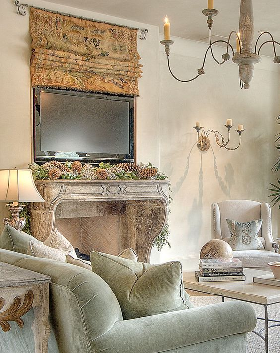 French Country decor in a living room with tapestry and French fireplace. ##livingroom #frenchcountry #frenchfarmhouse #europeanfarmhouse #interiordesignideas