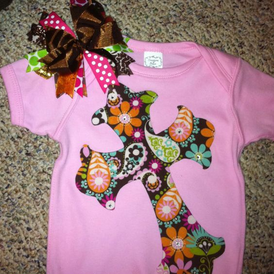 Iron on fabric to heat-n-bond, trace a pattern on fabric then cut out with scissors. Iron pattern on onesie and add rhinestones! Make bow to match =)