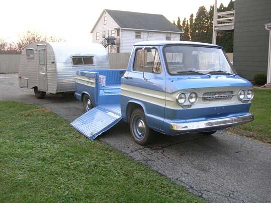 1961 Corvair Rampside pickup towing a 1961 13' Front Kitchen trailer