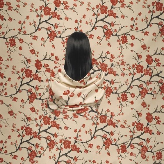 Another camouflaged body paint self-portrait by cecilia paredes
