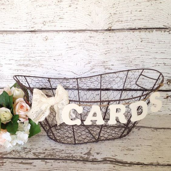 Rustic wire basket for holding wedding cards - 19 Wedding Gift Card Box Ideas. See more at http://blog.myweddingreceptionideas.com/2016/01/19-wedding-gift-card-box-ideas.html