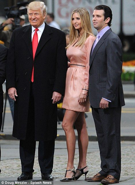 Donald Trump beams as he is flanked by Ivanka and his eldest, Donald Jr.