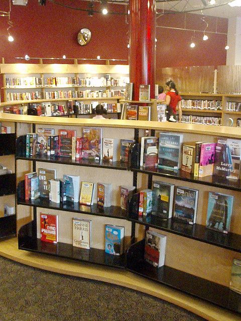 Nice curved display...   King County Library System, Washington by State Library of NSW Public Library Services, via Flickr