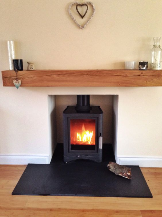 Wood burning stove, oak beam, slate hearth, Scottish home Scandinavian