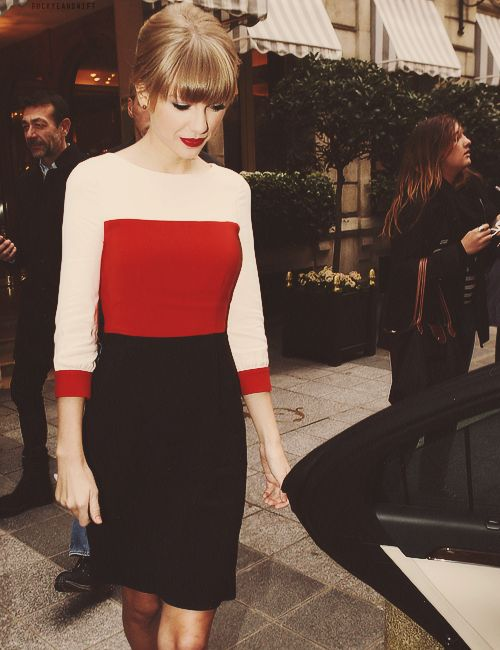 Swifty looking lady-like in a red & cream top paired with a classic black pencil skirt.: