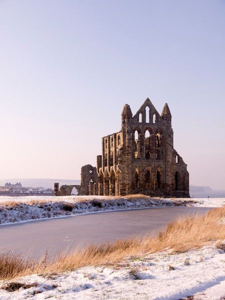 'Whitby Abbey Winter' The ruins of Whitby Abbey, North Yorkshire, England in snowy winter weather by Peter Jordan