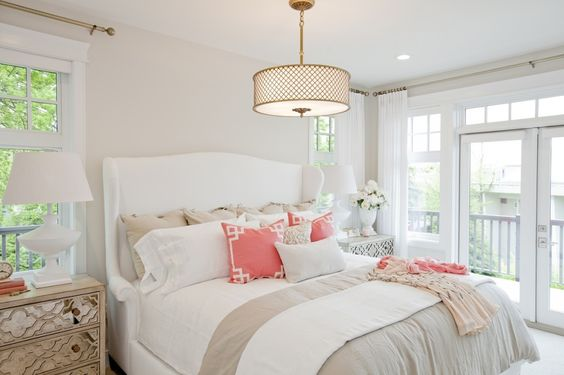 PNE Prize Home 2014 - luxurious neutral bedroom in layered tones of grey, sand, and white, with pops of coral as an accent.