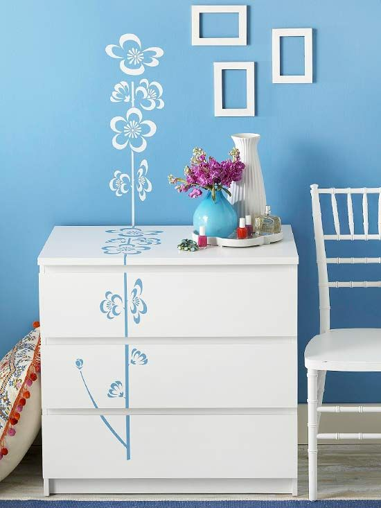 """Dainty Designs """"Bring an ordinary dresser to life with an oversize floral stencil. To keep the look graphic and the cost low, use leftover wall paint to apply the stencil to the dresser, and then repeat the pattern up the wall using white paint."""" Such a cute idea! Just don't plan to re-arrange the room right away!"""