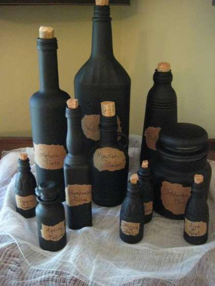 Empty condiment bottles spray painted black to look like witches potions
