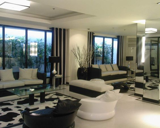 Mirrored wall and more white floors.