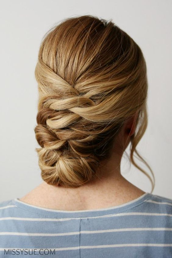Although this updo looks fancy, it's literally a series of pretty knots that end in a braid, and itÕs so easy. #updos #hairstyles #longhair #southernliving