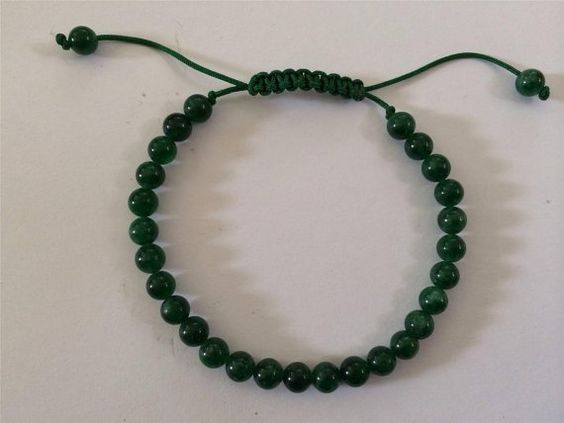 This lising is for a small green Jade wrist mala/ bracelet for meditation. There are 27 small green jade beads on the string. Each bead measures 6mm and it is made adjustable to fit most wrist size. Prayer Mala or beads are usually used by Buddhists around the world, especially in Tibet, Nepal and India and used for meditation, counting mantras, and prostration. Malas are worn on the left wrist while not in use. Please email me for more detail and I will be more than happy to assist you…