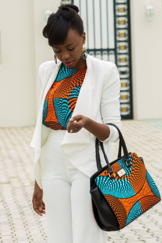 Corporate African Print Styles You Can Don To Your Office  Ever spent your morning deciding what to wear to work....? Perhaps you have a big meeting or maybe you would be out representing the company at an event...   Choosing a dress to wear to a corporate event or casual outing is dependent on the style of the dress. You won't want to show up at a book launch wearing a floor length ball dress. You would end up being a topic for discussion. With the hype in African textile,choosing a style for