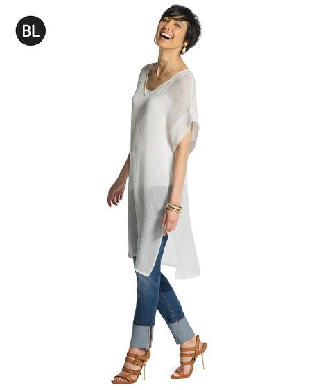 "V-neck tunic is long on style with a softly puckered texture and wide, short sleeves. Try it layered over a cami and belted with jeans.   Individual style. Clean, modern lines. The Exclusive Black Label by Chico's™ collection.   Semi-sheer.  Side slits.   Pleat at center back.   Length: 35""+.   Triacetate, polyester.   Imported."