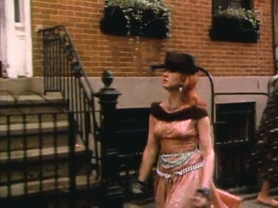 Here's a blurry screencap of Cyndi Lauper wearing the pink prom dress in her 'Girls Just Want to Have Fun' video.