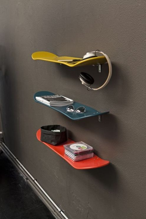 Such a great idea for people with kids or outgrown skateboards/snowboards... Just spray paint to match decor and use as shelving! Love this, practical idea!: