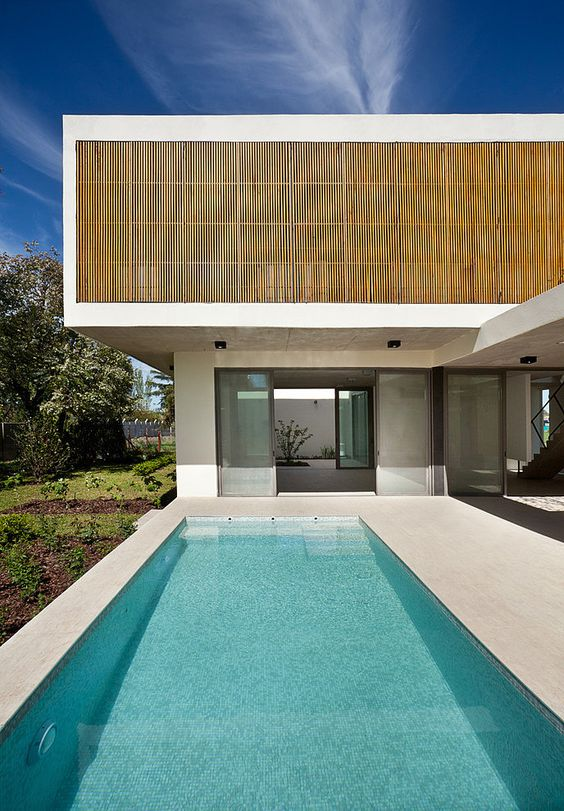 Casa Pedro by VDV ARQ, a modern two-storey single family residence in Argentina.