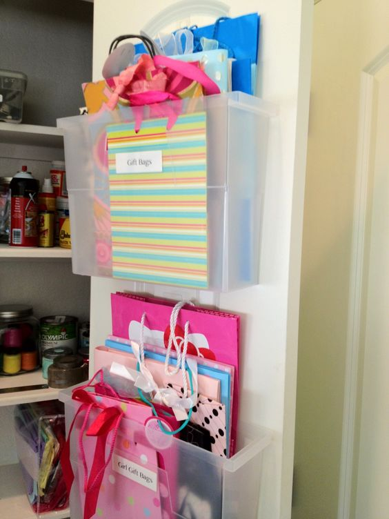 Gift bag storage! File folder containers attached with Velcro for easy adjustment and removal.