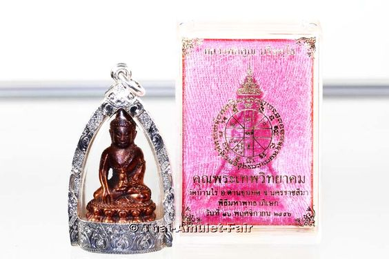 Buddha Thai Amulet Phra Kring Chinna Banchon Thep Vittayakom Nuea Nawa Loha with Silver bottom from the venerable Luang Pho Koon Parisuttho, abbot of Wat Banrai, Korat, Thailand, from Saturday the 11/16/2013.The amulet was created in a numbered small series of only 1.999 pieces. The amulet is in a handmade and watertight silver dimension casing. http://www.thai-amulet.com/Thai-Buddha-Amulets/Luang-Pho-Koon-Buddha-Thai-Amulet-Phra-Kring-Chinna-Banchon::3339.html
