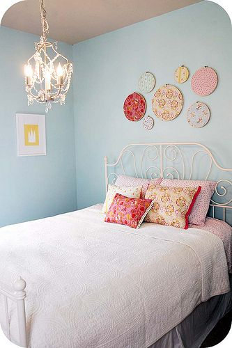 girl's bedroom with embroidery hoop wall art and a chandelier #girlsroom