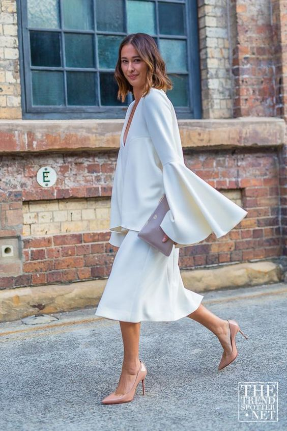 Amazing Fashion Week Australia 2015 Street Style - A white Ellery bell sleeve top + midi skirt worn with nude pointy toe pumps:
