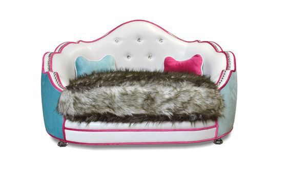 Pantages Doggie Bed    Here is a unique, luxurious doggie bed ($1,350) that has an oversize faux-fur pillow surrounded by a cozy outer couch and is finished with crystal buttons and tacks.