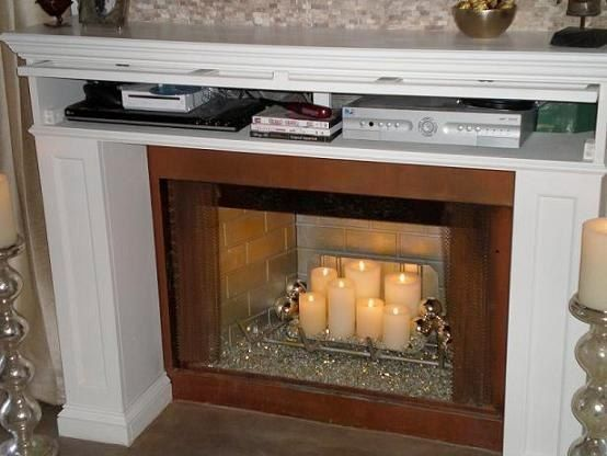 Mantel media storage hide the electronics for the home Hide fireplace ideas
