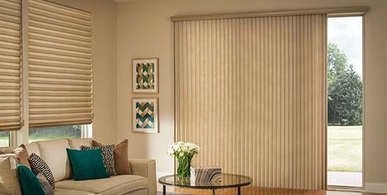Matching Roman Shades for windows & cellular shades on sliding glass doors with the same 2-inch pleat design.