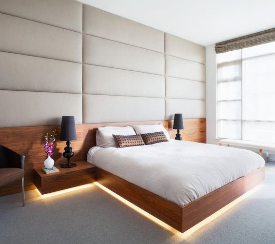 A modern bed with glowing lights underneath.