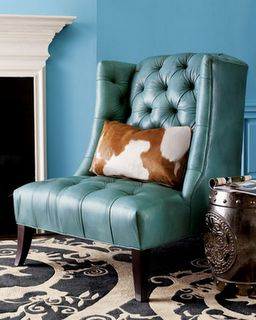 #Turquoise leather chair with cowhide pillow.