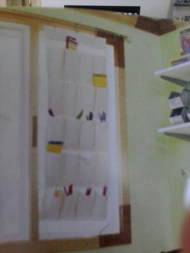 Use window space with a curtain rod, and clips of some kind to as storage space or hang artwork. See example above of smaller items such as paint brushes hanging from a window