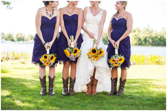 Purple Bridesmaids Dresses with Cowboy boots and Sunflower bouquets.: