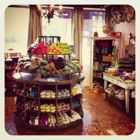 I need one of these for home and for the shop! <3! Yarn display at STASH, Calgary