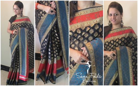 What do we call a Beautiful Black Brocade Designer Saree with lovely Copper Coloured Bhuttas all over with a beautiful Red Coloured Border on one side and a lovely Red n Blue COmbo Border on the other?? An Eternal Beauty...!!! With a Contrast Red Coloured Raw Silk Blouse, look absolutely Majestic !! Match the saree with some Beautiful Blings n love the attention in any party!!! :)
