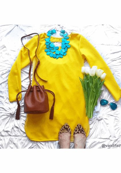 Take advantage of some rays of sunshine with this bright and flirty yellow cutout-back shift dress.