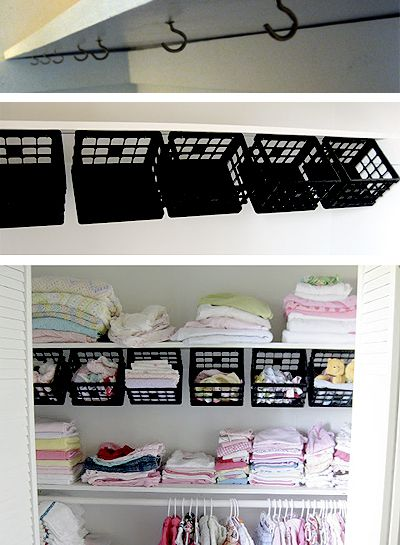 Some dollar store plastic mini-crates, some hooks under the top shelf and instantly a whole world of organizing possibilities opens up: