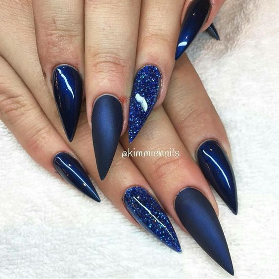 Blue stiletto nails with glitter                                                                                                                                                     More
