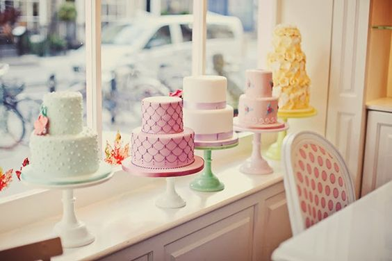 Beautiful Pastel Cakes Lined up in a cake shop window - Peggy Porschen