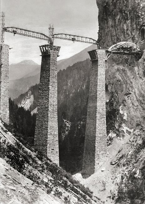 Construction of the Rhatian railway line 1900.  Prior to the construction of the railway, the journey from Chur through the Julier Pass to the Engadin took around 14 hours - today it takes just two by train. UNESCO World Heritage Site.   SWISS REVIEW - IMAGES