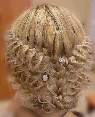 Wedding Hair: Braided updo--looks like three waterfall braids under each other, and the top row combines to a regular braid that you just flip under when everything's up