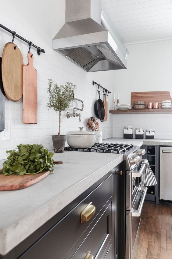 Are you considering new countertops in your kitchen? This post will talk about the pros and cons of Pre Cast vs Cast in Place Concrete Countertops and ultimately help you decide what's best for your home. #ConcreteCounterTops #KitchenDesign #Kitchens #KitchenCounterIdeas #CounterTops