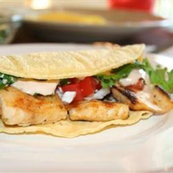 Grilled Fish Tacos with Chipotle-Lime Dressing: Cilantro Shredded, Chili Powder, Grilled Fish Tacos, Creamy Dressing, Peppers Garnished, Dressing Spiked, Chipotle Peppers