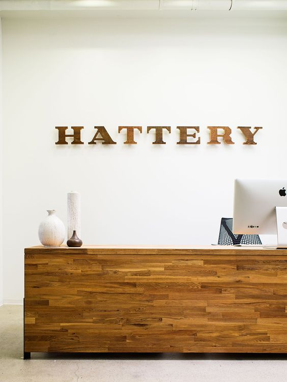 Hattery San Francisco, California Office Reception Desk...love the wood color