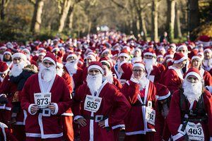 The start of the Santa Run in Battersea Park in London in aid of winter sports charity Disability Snowsport